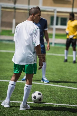Photo for Group of soccer players during soccer match on pitch - Royalty Free Image