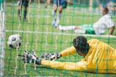 goalkeeper catching ball