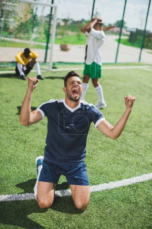 Photo for Happy soccer player celebrating goal during soccer match - Royalty Free Image