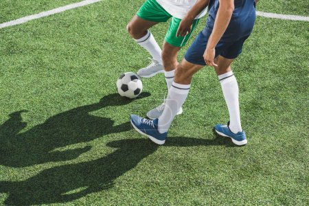 Photo for Partial view of athletic soccer players playing soccer on pitch - Royalty Free Image