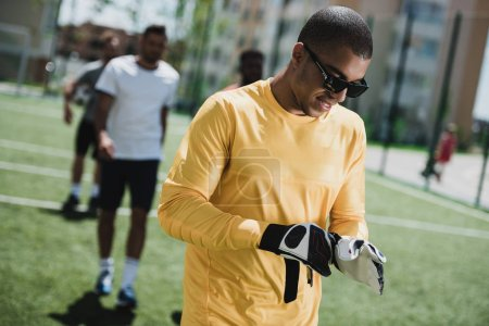 african american goalkeeper on pitch
