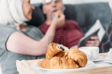 Photo for Selective focus of senior coupe having breakfast together in bed - Royalty Free Image