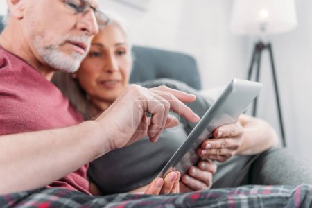 couple with tablet at home