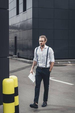 Stylish man with newspaper