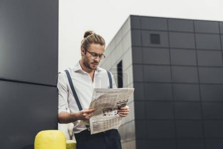 Stylish man with newspaper