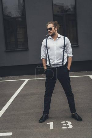 Handsome stylish man smoking