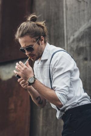 Stylish young man smoking
