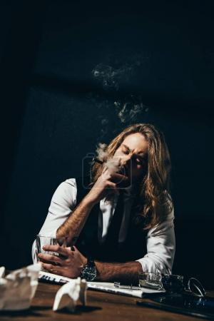 Man drinking alcohol and smoking