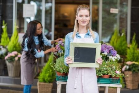 florist holding blank sign