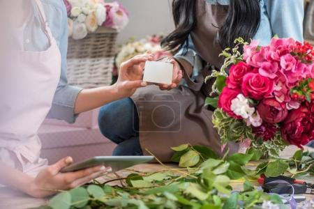 Florists holding blank card