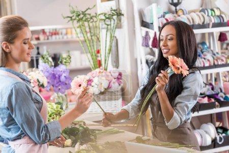 Multiethnic florists in flower shop