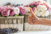 florist showing thumb up