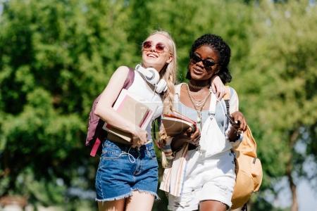 multiethnic students walking in park