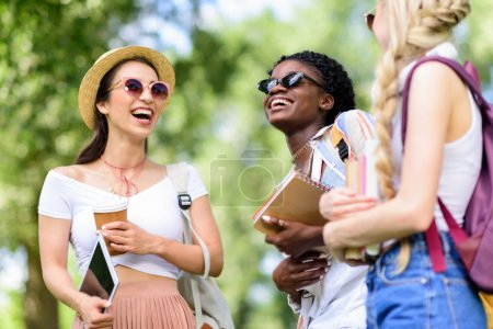 multiethnic students holding books