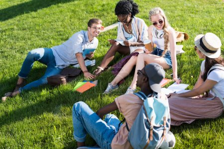 multiethnic students resting in park