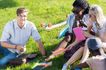 happy multiethnic students in park
