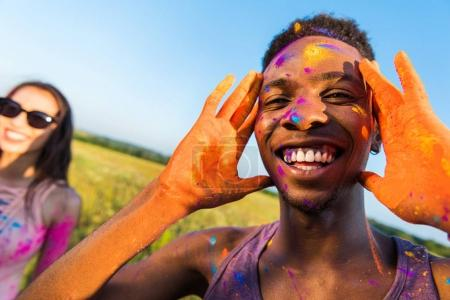 African american man in colorful paint