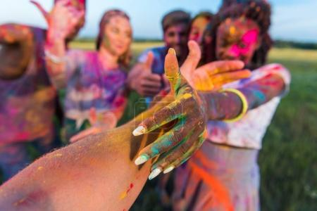 Photo for Happy young multiethnic friends having fun with colorful powder at holi festival of colors - Royalty Free Image