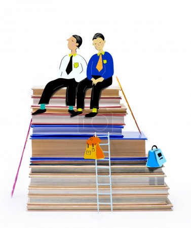 Pupils sitting on stack of books