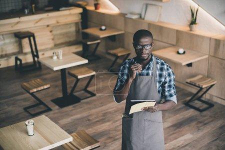 african american waiter taking order