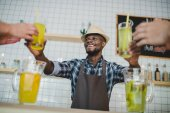 African american bartender with lemonades