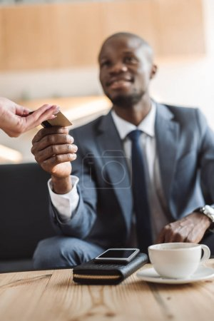 businessman paying with credit card