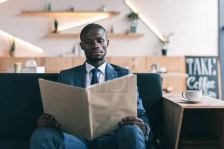 businessman reading menu in cafe