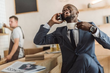 happy businessman talking on smartphone
