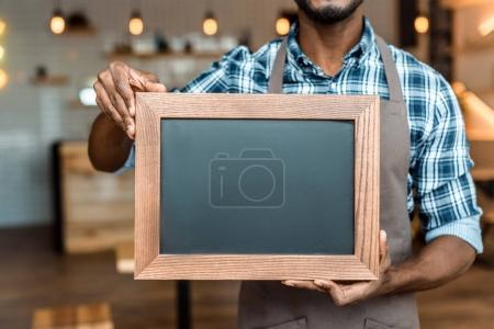 Owner holding empty blackboard