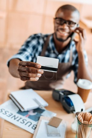 Waiter with credit card during payment