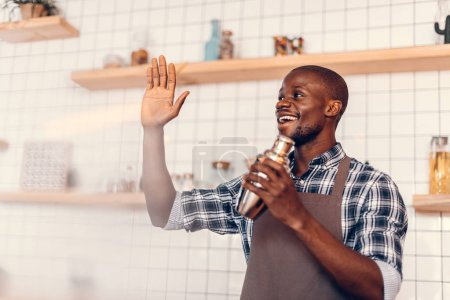 Smiling african american bartender