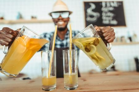 bartender pouring lemonades
