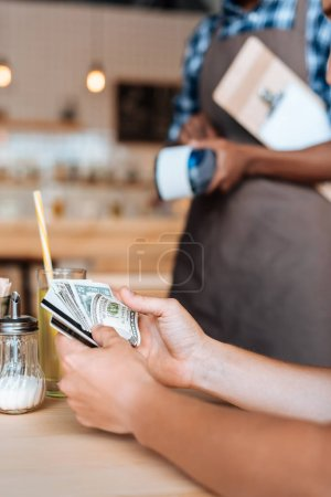 waiter taking cash payment