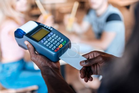 Waiter doing credit card payment