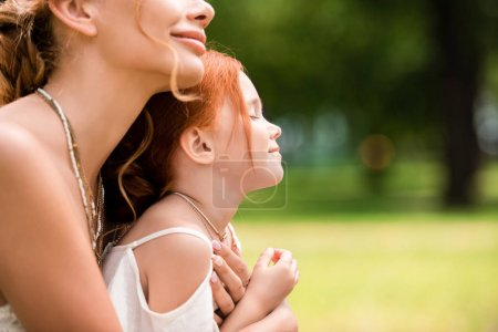Photo for Cropped shot of beautiful happy mother and daughter hugging at park - Royalty Free Image