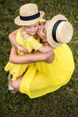 Mother and daughter hugging in park
