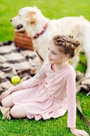 girl with dog at picnic