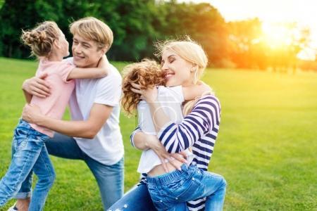 Family hugging in park