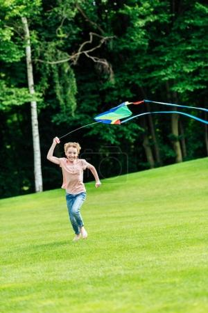 Girl playing with kite at park