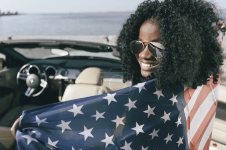 african american woman with american flag