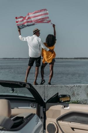 african american couple with american flag