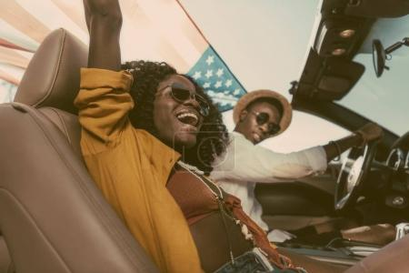 African american couple riding car