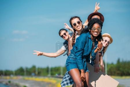Photo for Multiethnic happy young friends in casual clothing looking at camera - Royalty Free Image