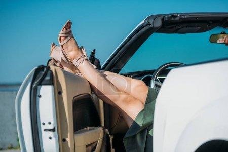 Woman resting in car