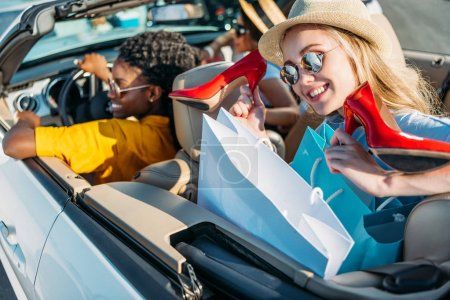multiethnic women in car after shopping
