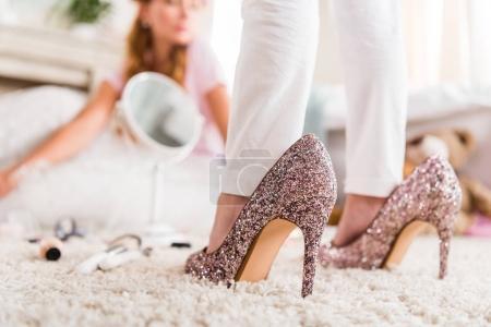 girl in mothers high heels