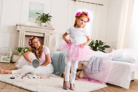 little girl in mothers high heels