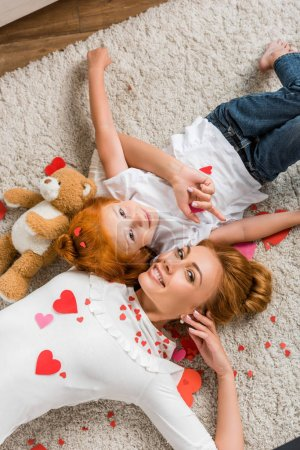 Mother and daughter with hearts and teddy bear