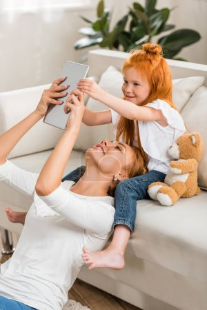 Mother and daughter using tablet together