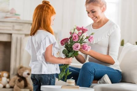 girl greeting mother on mothers day